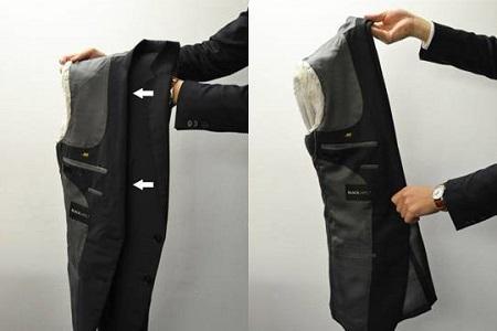 4,把衣服由下到上沿着中线折叠起来,这样外套就折叠好了.
