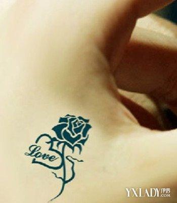 一:love玫瑰纹身:纹在手上虎口位置的love英文