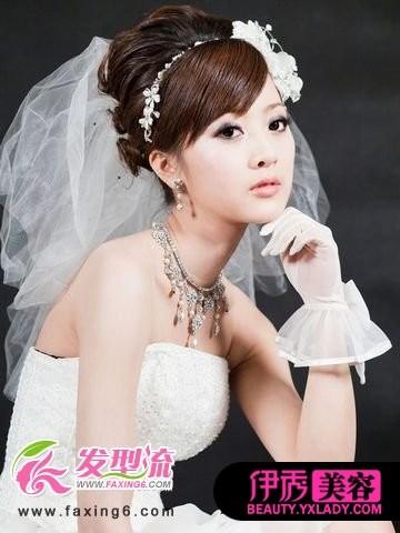 浪漫6月新娘发型 留住最美一刻 温婉的低盘发,让新娘的造型看起来图片